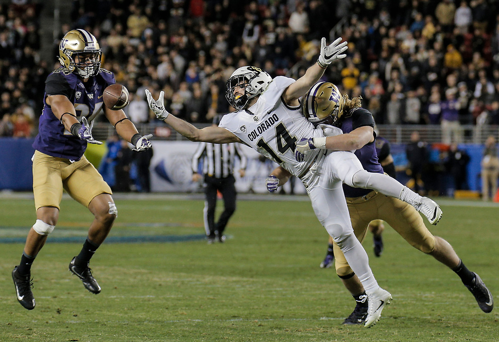 Dec 02, 2016  Santa Clara, CA : Colorado wide receiver Jay MacIntyre #14 tries to make a one handed catch just off his finger tips that turn into a interception during the NCAA Pac 12 Championship Football game between Washington Huskies and Colorado Buffaloes 41-10 lost at Levi Stadium Santa Clara Calif. Thurman James / CSM