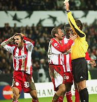 Champions League 23.11.05, Rosenborg - Olympiakos 1-1<br /> Anastasios Pantos receives his second yellow for the day, while Anatolakis and Touré plead in vain with referee Paul Allaerts, Belgium<br /> Foto: Carl-Erik Eriksson, Digitalsport