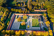 Nederland, Drenthe, Gemeente Noordenveld, 04-11-2018; gevangenisdorp Veenhuizen, gesticht in 1823 door de Maatschappij van Weldadigheid voor de heropvoeding van bedelaars en landlopers. Het Tweede Gesticht - met rood pannendak - is een van de oude dwanggestichten en huisvest nu het Gevangenismuseum.<br /> Veenhuizen prison village, founded in 1823 by the Benevolent Society for the rehabilitation of beggars and vagrants.<br /> The 'Second Establishment' - with red tile roof - is one of the old detention centers and now houses the Prison Museum.<br /> <br /> luchtfoto (toeslag op standard tarieven)<br /> aerial photo (additional fee required)<br /> copyright foto/photo Siebe Swart