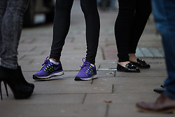 © Licensed to London News Pictures . 20/11/2014 . Kent , UK . A woman wearing purple trainers opposite the UKIP shop on High Street Rochester . The Rochester and Strood by-election campaign following the defection of sitting MP Mark Reckless from Conservative to UKIP . Photo credit : Joel Goodman/LNP