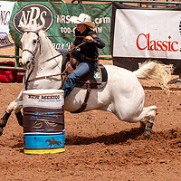 Photo: Jeffery Jones<br /> Katilyn Harwell rides her horse around the second barrel Saturday during the New Mexico High School Rodeo Association State Finals at Red Rock Park.  Harwelll completed her run with a time of 15.861 seconds.