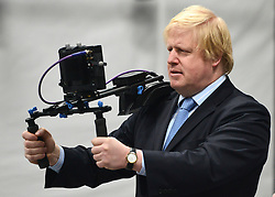 """© Licensed to London News Pictures. 04/04/2013. London, UK Boris Johnson films. Boris Johnson the Mayor of London, visits Ealing studios today, 4th April 2013, where he announced his plans to boost London's TV, Animation and Film industries, capitalising on the new tax relief brought in by the Chancellor (from 1st April 2013) to bring major jobs and investment to the capital. He toured the Studios and spent time in the """"Imaginarium"""", where he had a go at mastering 'performance capture'. . Photo credit : Stephen Simpson/LNP"""