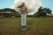 Pearl Harbor survivor, Gerald Glaubitz salutes an unknown soldier at National Memorial Cemetery of the Pacific, Hawaii on the 50th anniversary of the Japanese attack.