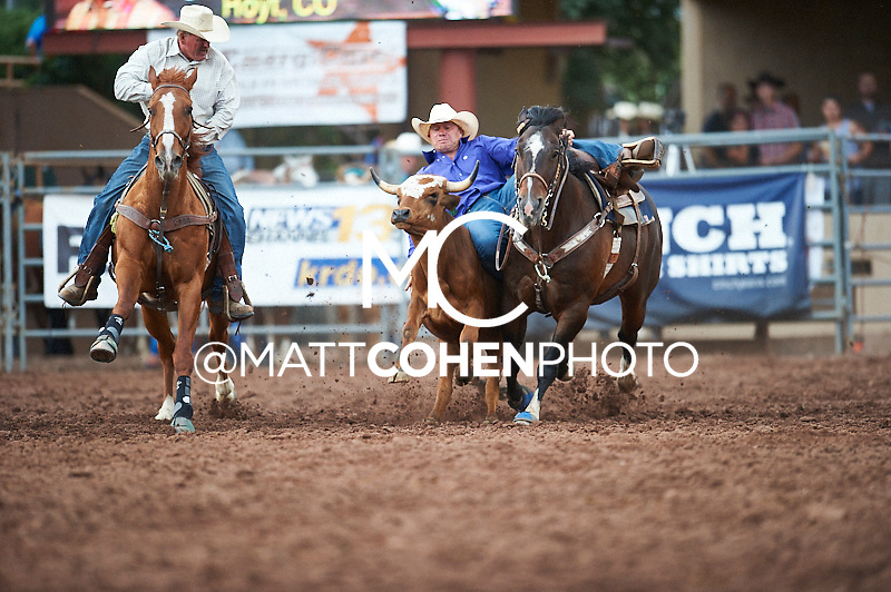 Steer wrestler Wyatt Johnson of Hoyt, CO competes at the Pikes Peak or Bust Rodeo in Colorado Springs, CO.<br /> <br /> <br /> UNEDITED LOW-RES PREVIEW<br /> <br /> <br /> File shown may be an unedited low resolution version used as a proof only. All prints are 100% guaranteed for quality. Sizes 8x10+ come with a version for personal social media. I am currently not selling downloads for commercial/brand use.