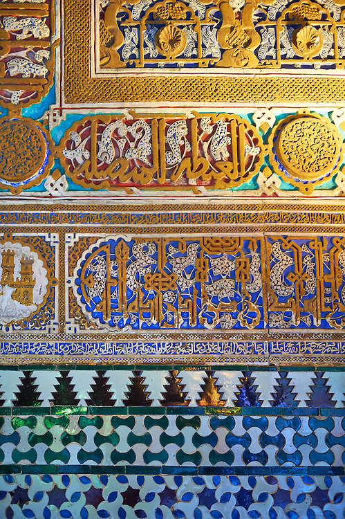Arabesque Mudjar plasterwork and tiles of the  Alcazar of Seville, Seville, Spain . The Royal Alcázars of Seville (al-Qasr al-Muriq ) or Alcázar of Seville, is a royal palace in Seville, Spain. It was built by Castilian Christians on the site of an Abbadid Muslim alcazar, or residential fortress.The fortress was destroyed after the Christian conquest of Seville The palace is a preeminent example of Mudéjar architecture in the Iberian Peninsula but features Gothic, Renaissance and Romanesque design elements from previous stages of construction. The upper storeys of the Alcázar are still occupied by the royal family when they are in Seville. <br /> <br /> Visit our SPAIN HISTORIC PLACES PHOTO COLLECTIONS for more photos to download or buy as wall art prints https://funkystock.photoshelter.com/gallery-collection/Pictures-Images-of-Spain-Spanish-Historical-Archaeology-Sites-Museum-Antiquities/C0000EUVhLC3Nbgw <br /> .<br /> Visit our MEDIEVAL PHOTO COLLECTIONS for more   photos  to download or buy as prints https://funkystock.photoshelter.com/gallery-collection/Medieval-Middle-Ages-Historic-Places-Arcaeological-Sites-Pictures-Images-of/C0000B5ZA54_WD0s