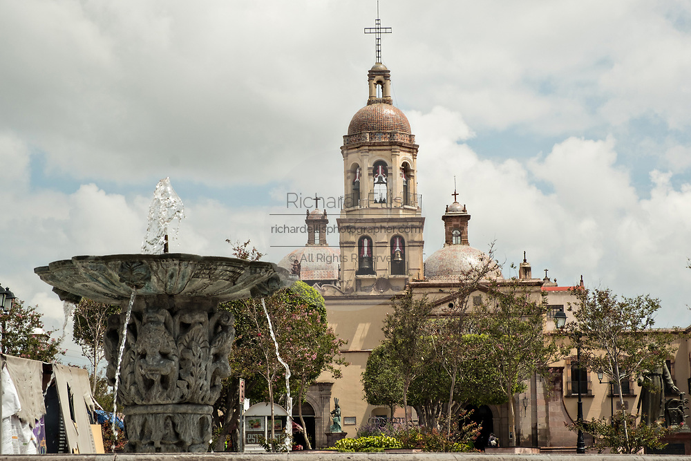 Fountain and Holy Cross Church and Franciscan Convent also called the Templo y Convento de la Santa Cruz on Founders Plaza in the old colonial section of Santiago de Queretaro, Queretaro State, Mexico.