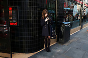 Girl texting on her mobile phone in London, United Kingdom. Tens of thousands of people gathered in the West End filling the streets and jpining in with the festival atmosphere.