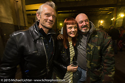 Mark Wilsmore of the Ace Cafe with Aileen Silvestris of the Moto Quest at a party at the Motosplash complex with a show opening of Michael Lichter photographs in the Italian Choppers gallery during EICMA, the largest international motorcycle exhibition in the world. Milan, Italy. November 20, 2015.  Photography ©2015 Michael Lichter.