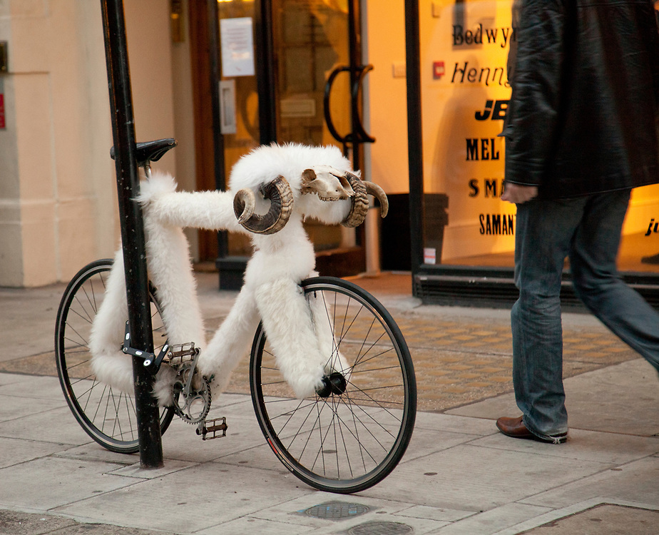 Rams Head Bicycle handles adorn a sheep skin covered bicycle in London.  Licensing and Open Edition Prints.