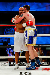 Bristol Rovers fan Duane Winters (aka The Gasman, blue and white shorts) celebrates a points victory over Darren Pryce (white shorts) in a Super Bantamweight bout on the undercard - Photo mandatory by-line: Rogan Thomson/JMP - 07966 386802 - 13/06/2015 - SPORT - BOXING - Bristol, England - Action Indoor Sports Arena - Lee Haskins vs Ryosuke Iwasa - Interim IBF World Bantamweight Title Fight - UNDERCARD.