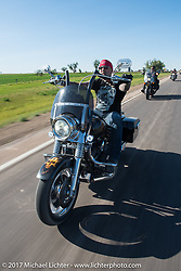 Riding south on highway 79 on the Run to the Line after lunch and the biker vs Cowboy rodeo games at the Spur Creek Ranch in Newell during the annual Sturgis Black Hills Motorcycle Rally. SD, USA. Wednesday August 9, 2017. Photography ©2017 Michael Lichter.