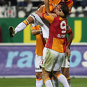 Galatasaray's Johan Elmander (R) with Emre Colak (C) Selcuk inan (L) celebrating his goal during their Turkish Superleague soccer derby match Besiktas between Galatasaray at the Inonu Stadium at Dolmabahce in Istanbul Turkey on Thursday, 26 August 2012. Photo by TURKPIX