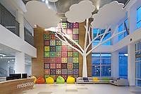 Interior of Novopechersky school in Kyiv. Reception area, sunset view. Design of interior: Dreamdesign.<br /> Фотосъемка интерьера школы. Вечернее время выбрано для цветового баланса.