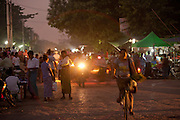 A busy evening street market along the Irrawaddy river in Mandalay, Myanmar