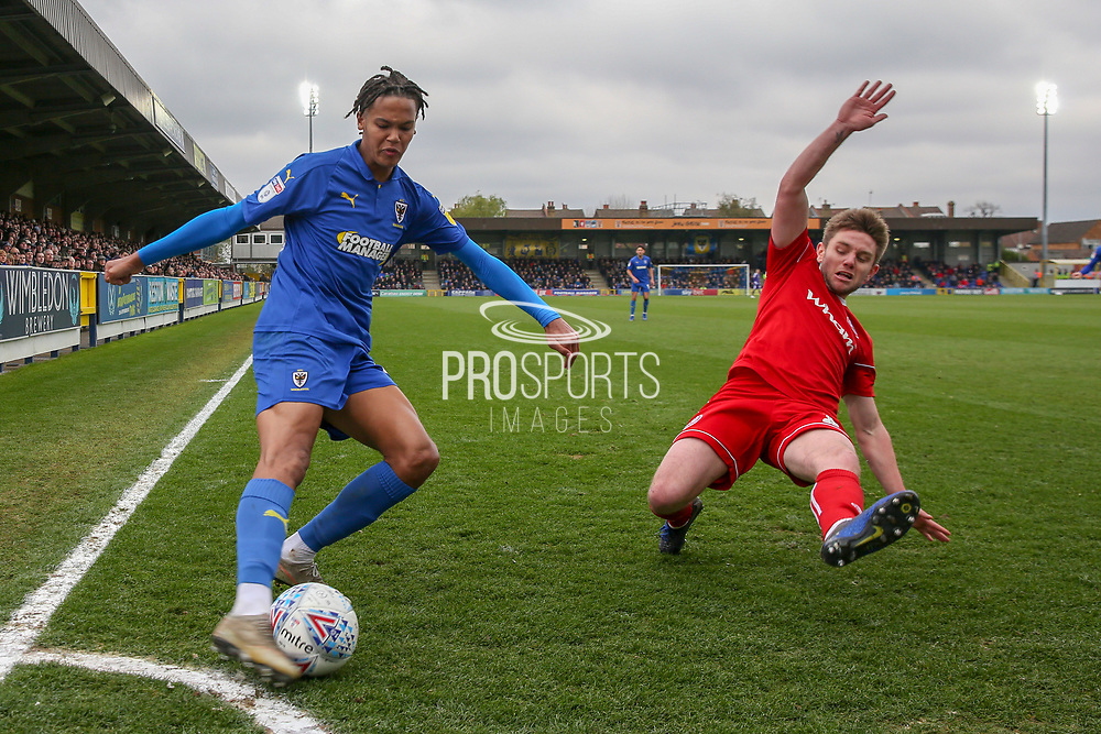 AFC Wimbledon defender Toby Sibbick (20) crossing the ball during the EFL Sky Bet League 1 match between AFC Wimbledon and Accrington Stanley at the Cherry Red Records Stadium, Kingston, England on 6 April 2019.
