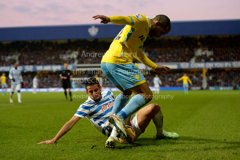 Mauricio Isla of QPR intercepting Jason Puncheon of Crystal Palace. Barclays Premier league match, Queens Park Rangers v Crystal Palace at Loftus Road in London on Sunday 28th December 2014.<br /> pic by John Patrick Fletcher, Andrew Orchard sports photography.
