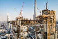 Aerial view of skyscrapers under construction close by the Burj Khalifa tower in Dubai, U.A.E.