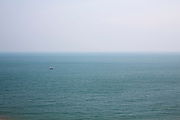 A fishing trawler boats sailing and fishing in the calm waters of The English Channel photographed from Folkestone, Kent, England, United Kingdom. (photo by Andrew Aitchison / In pictures via Getty Images)