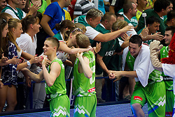 Klemen Prepelic of Slovenia, Miha Lapornik of Slovenia, Alen Omic of Slovenia and Marko Pajic of Slovenia celebrate after the basketball match between National teams of Latvia and Slovenia in Qualifying Round of U20 Men European Championship Slovenia 2012, on July 16, 2012 in Domzale, Slovenia. Slovenia defeated Latvia 69-62. (Photo by Vid Ponikvar / Sportida.com)