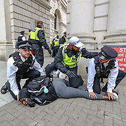 Police arrest a protestor during clashes with protesters in central London on Wednesday, June 3, 2020, after a demonstration over the death of George Floyd, a black man who died after being restrained by Minneapolis police officers on May 25. Protests have taken place across America and internationally after a white Minneapolis police officer pressed his knee against Floyd's neck while the handcuffed black man called out that he couldn't breathe. The officer, Derek Chauvin, has been fired and charged with murder. (Photo/ Vudi Xhymshiti)