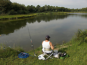 man sitting at a fishing lake Holland