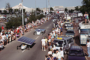 Starting line of the Pentax Solar Car Race, the first international solar-powered car race, November 2, 1987, Darwin, Northern Territory, Australia. Cars raced 1,950 miles across Australia (north to south) using only solar energy to power the cars.