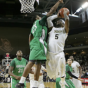 Central Florida guard Marcus Jordan (5) drives against Marshall guard Shaquille Johnson (23) during a Conference USA NCAA basketball game between the Marshall Thundering Herd and the Central Florida Knights at the UCF Arena on January 5, 2011 in Orlando, Florida. Central Florida won the game 65-58 and extended their record to 14-0.  (AP Photo/Alex Menendez)