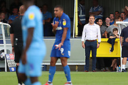 AFC Wimbledon manager Neal Ardley looking on at a decision that went against AFC Wimbledon striker Kweshi Appiah (9) during the EFL Sky Bet League 1 match between AFC Wimbledon and Coventry City at the Cherry Red Records Stadium, Kingston, England on 11 August 2018.