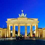 High resolution panorama of the Brandenburg Gate (Brandenburger Tor) in Berlin, Germany, taken from directly front on. Light streaks from passing cars.