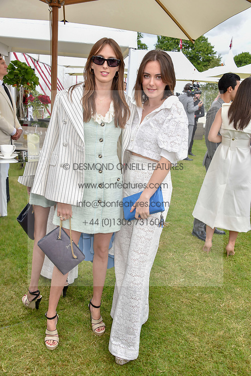 Left to right, Lady Alice Manners and Lady Eliza Manners at the Cartier Queen's Cup Polo 2019 held at Guards Polo Club, Windsor, Berkshire. UK 16 June 2019. <br /> <br /> Photo by Dominic O'Neill/Desmond O'Neill Features Ltd.  +44(0)7092 235465  www.donfeatures.com
