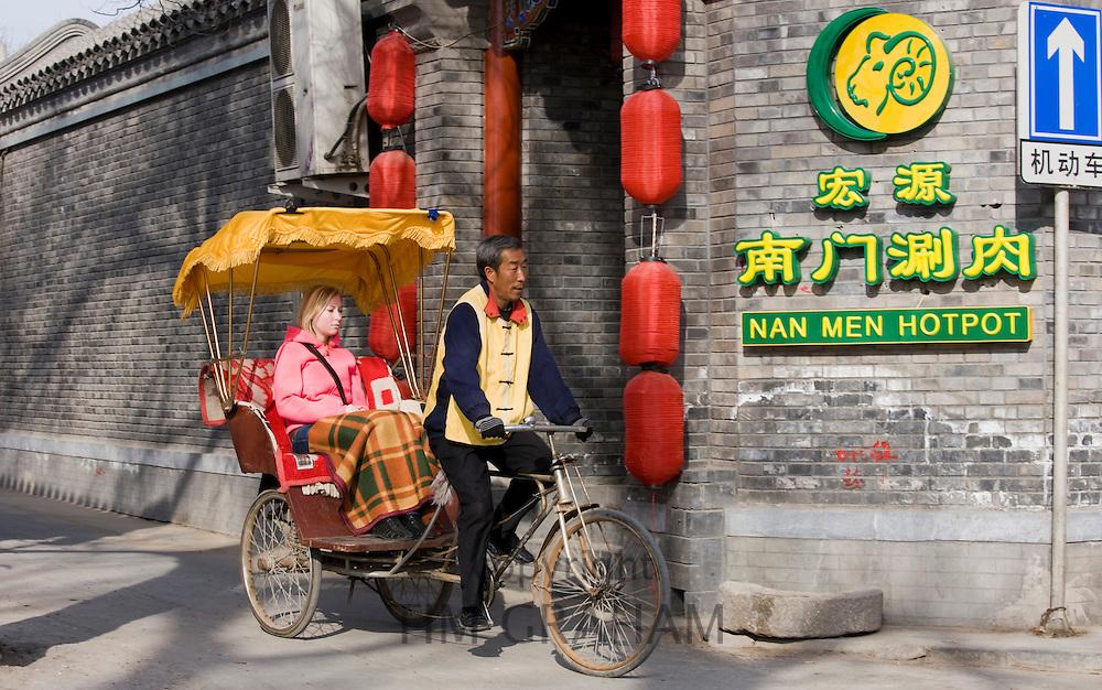 Western tourist in a rickshaw, Hutongs area, Beijing, China