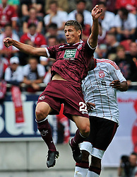 24.07.2010, Fritz-Walter Stadion, Kaiserslautern, GER, 1. FBL, Friendly Match, 1.FC Kaiserslautern vs FC Liverpool, im Bild Ivo ILICEVIC (Kaiserslauern #22 KRO) im Kopfballduell mit David NGOG (Liverpool #9), EXPA Pictures © 2010, PhotoCredit: EXPA/ nph/  Roth+++++ ATTENTION - OUT OF GER +++++ / SPORTIDA PHOTO AGENCY