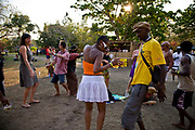 Foreign tourists and local Malawian party goers, dancing and getting into the groove and spirit of the Lake of Stars music Festival, with a mix of African bands and UK Dj's from London and Liverpool. Chinteche, Malawi.