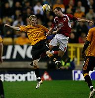 Photo: Steve Bond/Sportsbeat Images.<br />Wolverhampton Wanderers v Bristol City. Coca Cola Championship. 03/11/2007. Louis Carey  (R) wins the ball in the air