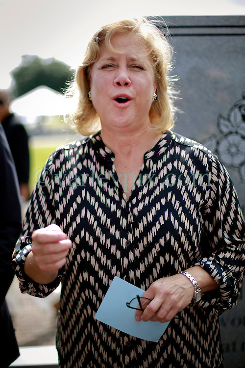 29 August 2014. Lower 9th Ward, New Orleans, Louisiana. Senator Mary Landrieu lays a wreath at the official memorial in remembrance of the day Hurricane Katrina swamped the community 9 years ago today..<br /> Photo; Charlie Varley/varleypix.com
