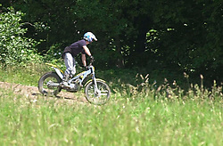 A second biker riding ilegally on land at Westood country park seems to spot the police activity before making good his escape <br />Police operation against illegal off road biking in the High Green area Sunday <br /><br />Image Copyright Paul David Drabble<br /><br />29 June 2003<br /><br />Copyright  Paul David Drabble<br /><br />[#Beginning of Shooting Data Section]<br />Nikon D1 <br /><br />2003/06/29 12:30:50.1<br /><br />JPEG (8-bit) Fine<br /><br />Image Size:  2000 x 1312<br /><br />Color<br /><br />Lens: 80-200mm f/2.8-2.8<br /><br />Focal Length: 200mm<br /><br />Exposure Mode: Programmed
