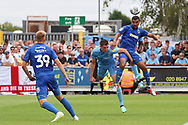 AFC Wimbledon striker Kweshi Appiah (9) winning header and trying to set up AFC Wimbledon striker Joe Pigott (39) during the EFL Sky Bet League 1 match between AFC Wimbledon and Coventry City at the Cherry Red Records Stadium, Kingston, England on 11 August 2018.