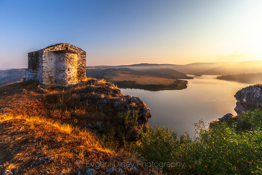 Pchelina lake with the old chapel at sunrise