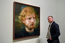 © Licensed to London News Pictures. 03/05/2017. London, UK.  Artist Colin Davidson stands with his portrait of the popular singer-songwriter Ed Sheeran, which has been newly acquired by the National Portrait Gallery.  The 4ft x 4ft painting oil painting is the first portrait painted of the singer since the start of his professional career and has just been put on public display.   Photo credit : Stephen Chung/LNP