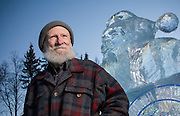 """Gabby Gaborik, Chief Elf who answers letters to """"Santa Claus"""", in North Pole, Alaska. Photographed with an ice scupture of Santa Claus, in North Pole, Alaska  by Brian Smale, for People Magazine."""