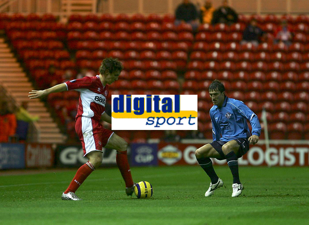 Photo: Andrew Unwin.<br />Middlesbrough v Dnipro. UEFA Cup. 03/11/2005.<br />Middlesbrough's Emanuel Pogatetz (L) plays the ball away from Dnipro's Dmytro Semochko (R).