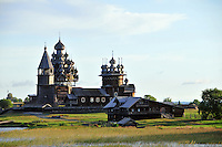 An early morning approach to Kizhi Island, in Russia's Lake Onega. The island is home to the world-famous Transfiguration Church, on the left, a timbered marvel with 22 onion domes built without a single nail. Over the years a number of other traditional wooden structures have been moved from Karelia to preserve them, and the island is now a UNESCO World Heritage site.