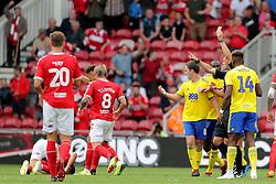 Referee Andrew Madley shows Birmingham City's Craig Gardner a straight red