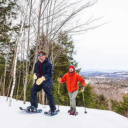 Two men snowshoeing at Loon Echo Land Trust's Bald Pate Mountain Preserve in South Bridgton, Maine.