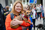 A woman with her dog wearing an end the chaos badge joins pet owners to take part in an anti Brexit Wooferendum rally on October 07, 2018 in London, England to protest against Britain leaving the European Union.