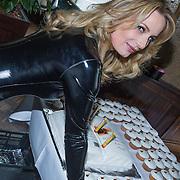 """NLD/Amsterdam/20130613 - Presentatie erotische triller """" Kamer 303 """" van Claudia Schoemacher - van Zweden in latex catsuit,"""