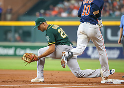 April 29, 2018 - Houston, TX, U.S. - HOUSTON, TX - APRIL 29:  Oakland Athletics first baseman Matt Olson (28) gets an out on Houston Astros first baseman Yuli Gurriel (10) in the bottom of the second inning during the baseball game between the Oakland Athletics and Houston Astros on April 29, 2018 at Minute Maid Park in Houston, Texas.  (Photo by Leslie Plaza Johnson/Icon Sportswire) (Credit Image: © Leslie Plaza Johnson/Icon SMI via ZUMA Press)