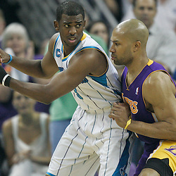 April 24, 2011; New Orleans, LA, USA; New Orleans Hornets point guard Chris Paul (3) is guarded by Los Angeles Lakers point guard Derek Fisher (2) during the first quarter in game four of the first round of the 2011 NBA playoffs at the New Orleans Arena.    Mandatory Credit: Derick E. Hingle