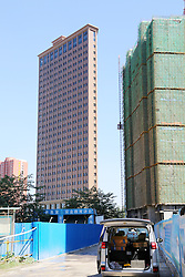 September 6, 2016 - Zhengzhou, Zhengzhou, China - Zhengzhou,CHINA-?September 2 2016:?(EDITORIAL?USE?ONLY.?CHINA?OUT) A paper-thin building in Zhengzhou, capital of central China¡¯s Henan Province. Residents living in buildings nearby call the building as ¡®paper-thin building¡¯ and think it¡¯s not safe to live in. It¡¯s introduced that the property developers of the building try to make best use of the land, which leads to the visual illusion of paper-thin building. Besides, it¡¯s safe to live in the ¡®paper-thin¡¯ building. (Credit Image: © SIPA Asia via ZUMA Wire)