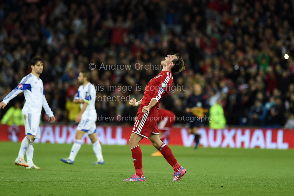 Gareth Bale of Wales shows his delight at final whistle after his team win 2-1.  Euro 2016 qualifying group B match, Wales v Cyprus at the Cardiff city Stadium in Cardiff, South Wales on Monday 13th Oct 2014.<br /> pic by Andrew Orchard, Andrew Orchard sports photography.